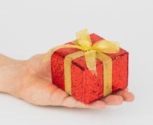 Person offering a gift
