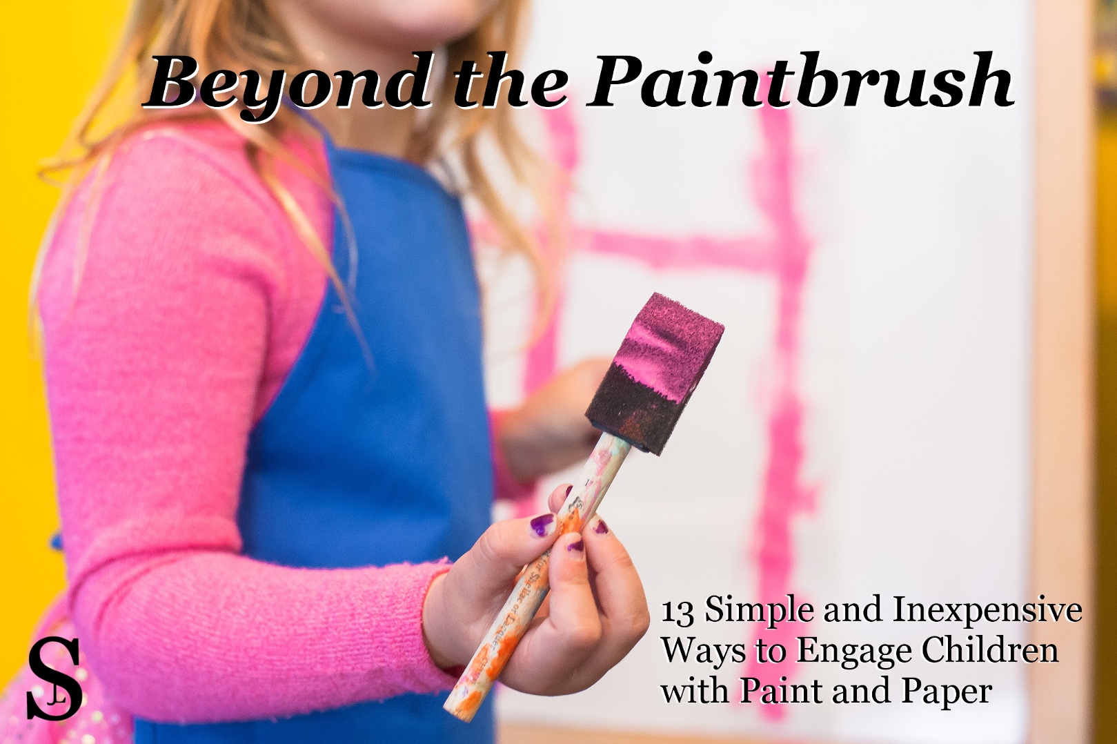 Girl holding paintbrush