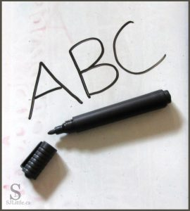 The letters ABC written on a whiteboard
