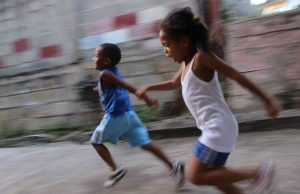 Two children running fast