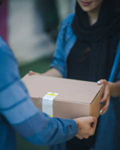 Person delivering package to someone