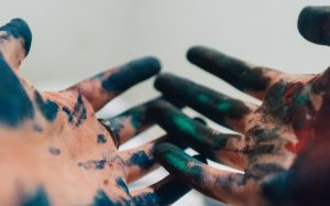 Hands with paint on them