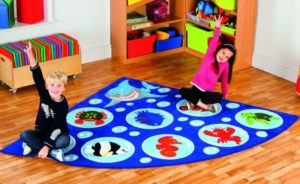Preschoolers sitting on corner circletime rug