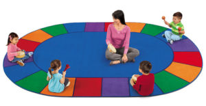 Children sitting on rug for circletime