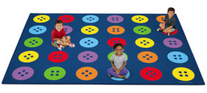 Children sitting on large classroom carpet