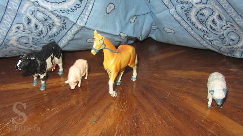 Farm animal toys under bandana