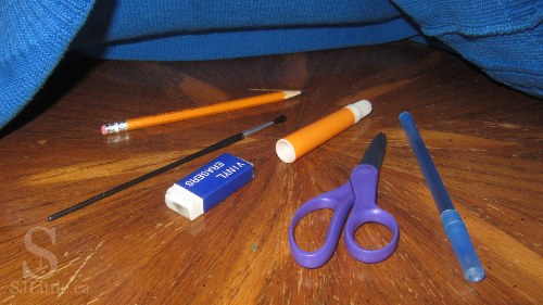 Various office supplies under cloth