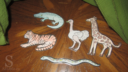 Zoo animal cut outs under cloth