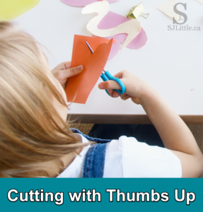Young girl using scissors